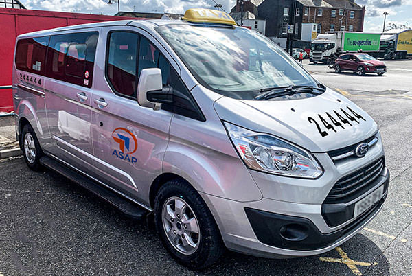 asap's 8 seat silver ford transit taxi minibus outside the red funnel terminal in east cowes